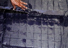 Cutting indigo dye cakes in Tamil Nadu